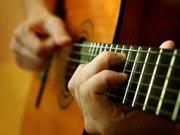 Научиться играть на гитаре просто